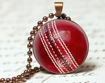 Cricket ball pendant necklace