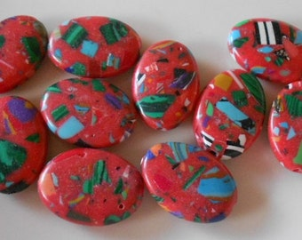 Pack of 10 synthetic howlite oval beads, red multi