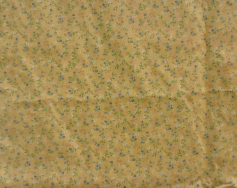 "Yellow cotton fabric with tiny blue, pink and white flowers. By the yard. 44"" wide."