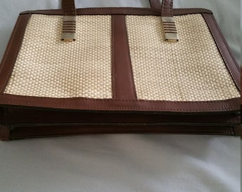 Reem Leather and Weave Handbag.