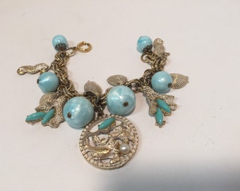 Vintage beach themed nautical gold tone and turquoise charm bracelet