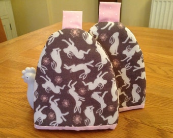 Egg cosy pair with a hare print fabric