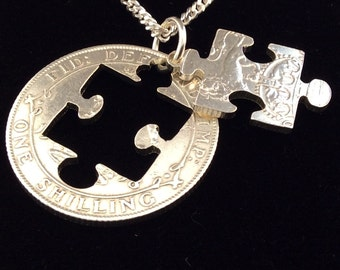 Jigsaw pendant made from a silver shilling on sterling silver chain.