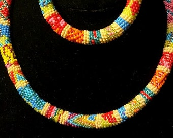 Alegria, necklace and bracelet in  warm and bright colors. A serious eyecatcher.