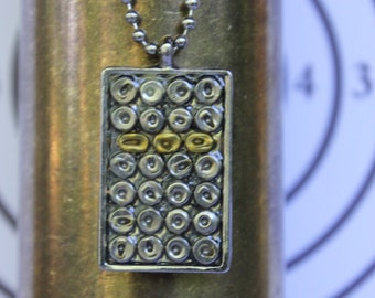 """Bullet Primer Necklace: Spent Nickel and Brass Bullet Primers in a Nickel Pendant on 30"""" Nickel Plated Steel Ball Chain Necklace."""