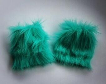 Turquoise furry leg warmers