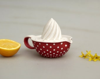 Red lemon squeezer with white dots