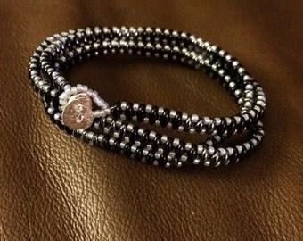 Black, hematite, and silver wrap bracelet