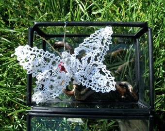 Textile art, fake taxidermy, propagator with butterfly lace bobbin