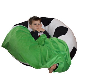 Soccer ball bean bag chair with blanket of grass