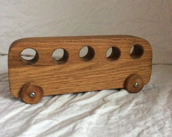 Vintage Waldorf style wooden toy bus. Handmade by ABC Industries.