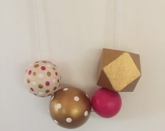 Wooden bead necklace // hot pink, gold, dots and geometric // hand painted