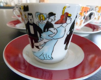 Vintage Maxim's coffee cups with comedy Belle Epoch decoration they are famous for. Parisian coffee cups.
