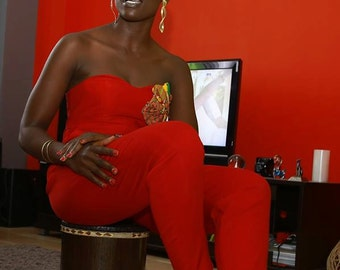 Red jumpsuit with kente detail