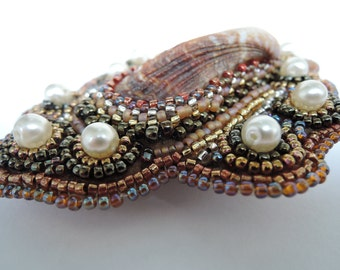 Hand beaded shell brooch