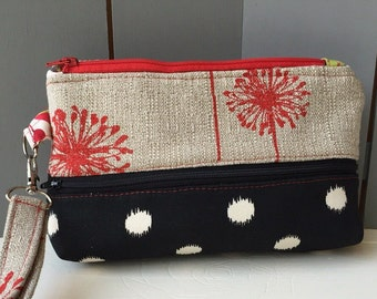 Black, tan, red fabric double zip wristlet clutch purse