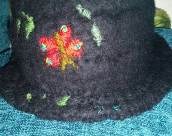 The black hand felted butterfly hat.
