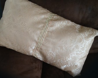 Gold pin tuck oblong cushion