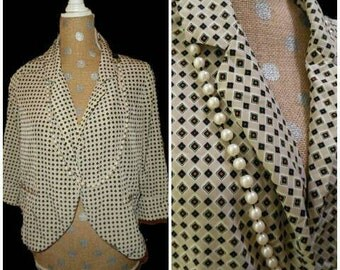 Retro 70's inspired diamond pattenered polyester blazer top.