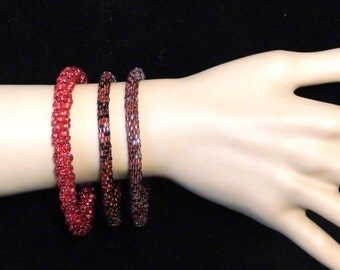 Three red beaded bracelets from the 1920's