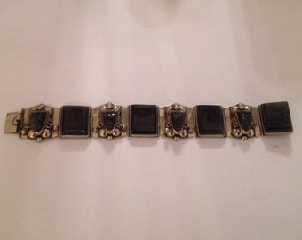 TAXCO Sterling Silver Bracelet with Moss Agate Panels & Carved Warrior Masks..1940