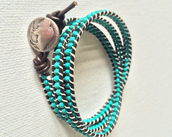 Turquoise triple wrap bracelet with dark brown leather cord