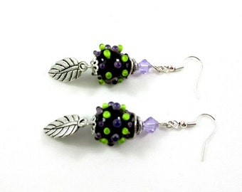 green and purple earrings