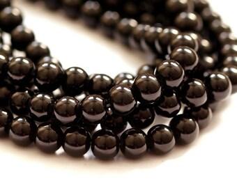 50 St. 8 mm glass Pearl / black