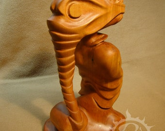 Wooden sculpture. Wood Carving.Mystical figurine of a fantastic being. Hofranoid