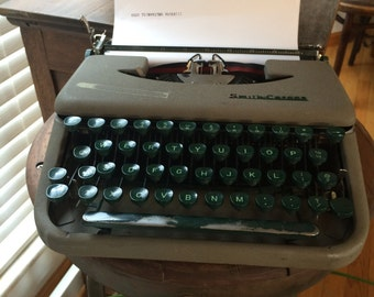 Vintage Lightweight Compact Portable Green and White Smith-Corona Skyriter Manua Typewriter from the 1950s in Carrying Case