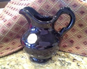 Petite black glossy pitcher by Frankoma