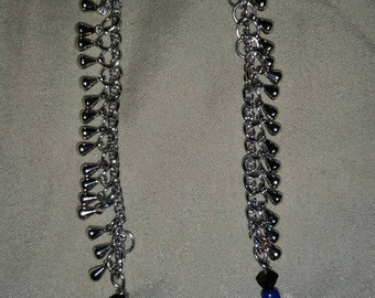 Stainless steel, long dangle earrings.