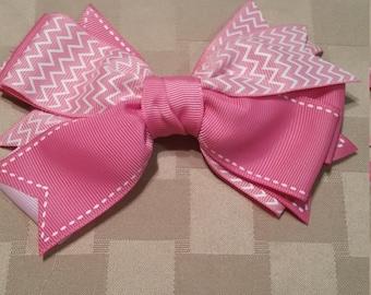 Pink pinwheel bow