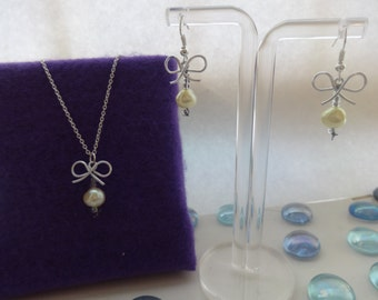 yellow bow and pearl jewellery set