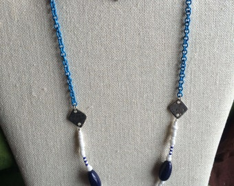 Blue chain and white beads