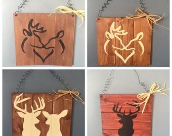 Deer silhouttes on wood panel