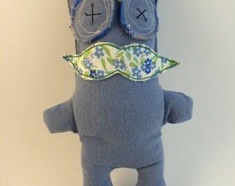 Blue stuffed toy monster. Moustache monster.  Blue plush toy monster. Little blue monster