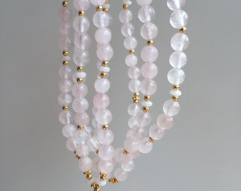 Mala decorated end bead Rose Quartz Rose Quartz, snow quartz and gold, satin-finish