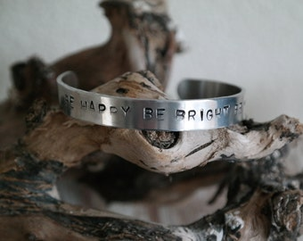 """Bracelet with text """"Be happy be bright be you"""""""