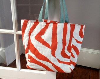 Orange and white canvas tote
