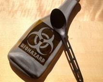 Imperfect Biohazard Melted Bottle Cheese Tray, Flattened Bottle Spoon Rest, Slumped Glass Bottle, Sandblasted Bio Hazard Design