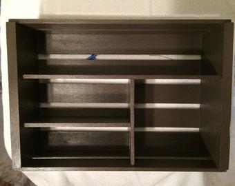 Shelf unit.  Wood, painted dark brown.