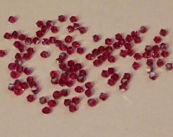 100+ 4mm bicone Swarovski Crystals in Lt Siam AB