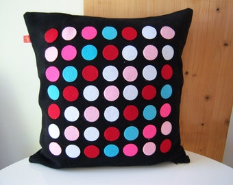 blue and black dotted felt pillow
