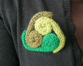 Hand knitted green wool brooch  celtic knitted brooch   green triskelion brooch   triskelion brooch