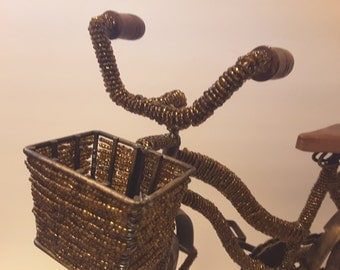 Yes....a beaded bicycle with basket,amber colored beads
