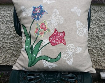 FLORAL CUSHION COVER- contemporary appliquéd design of butterflies and flowers on linen