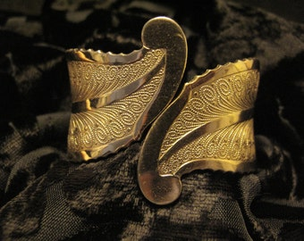 Gold Tone Hinged Cuff Bracelet With Feather Design