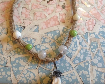 Hemp necklace with glass beads and wire wrapped crystal pendant