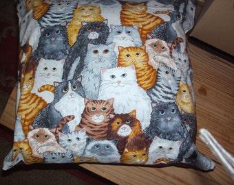 cushion, with cartoon cats.